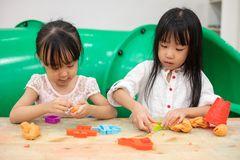 Asian Little Chinese Girls Playing Colorful Clay. In Indoor Playground stock photography
