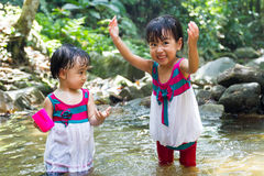 Asian Little Chinese Girls Playing in Creek Stock Photos