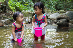 Asian Little Chinese Girls Playing in Creek Royalty Free Stock Photography