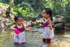 Asian Little Chinese Girls Playing in Creek Royalty Free Stock Images
