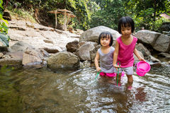 Asian Little Chinese Girls Playing in Creek Stock Images