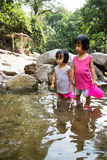 Asian Little Chinese Girls Playing in Creek Stock Photography