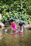 Asian Little Chinese Girls Playing in Creek Royalty Free Stock Image