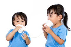 Asian Little Chinese Girls Playing with Paper Cups Stock Photography