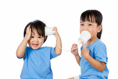 Asian Little Chinese Girls Playing with Paper Cups Royalty Free Stock Photography