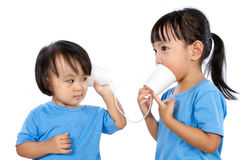 Asian Little Chinese Girls Playing with Paper Cups Royalty Free Stock Photos