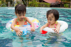 Asian Little Chinese Girls Playing in Swimming Pool Stock Photography