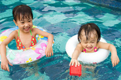 Asian Little Chinese Girls Playing in Swimming Pool Stock Photo