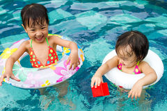 Asian Little Chinese Girls Playing in Swimming Pool Royalty Free Stock Images