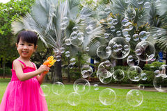 Asian Little Chinese Girls Shooting Bubbles from Bubble Blower Royalty Free Stock Photography