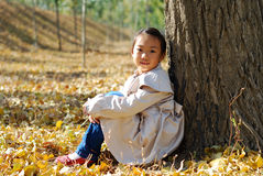 Asian little girl in autumn. Very cute Royalty Free Stock Images