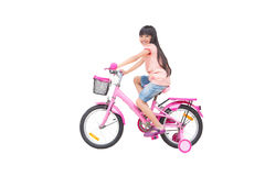 Asian little girl on bicycle. Isolated on white Royalty Free Stock Images
