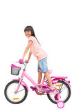 Asian little girl on bicycle. Isolated on white Royalty Free Stock Image