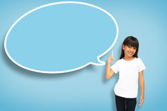 Asian little girl with blank speech bubble. Smile asian little girl with blank speech bubble on blue background Stock Photo