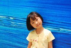Asian little girl on blue background stock images