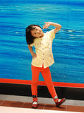 Asian little girl on blue background Stock Photography