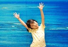 Asian little girl on blue background stock photos
