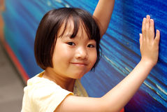 Asian little girl on blue background Royalty Free Stock Photography