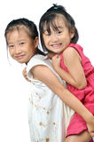 Asian little girl carries her sister on her back Royalty Free Stock Photos