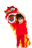Asian Little Girl in Chinese Lion Custome Dance During Chinese N Stock Images
