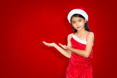 Asian little girl in Christmas suit with an empty hands Royalty Free Stock Images