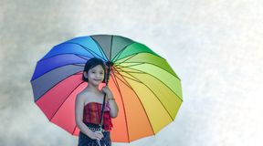 Asian little girl with colorful umbrella Stock Images