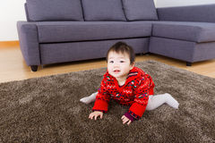 Asian little girl crawling on carpet Royalty Free Stock Images