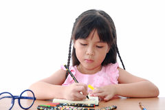 Asian little girl draw on a book Royalty Free Stock Photography