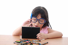 Asian little girl draw on a book Royalty Free Stock Photo