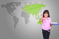 Asian little girl with drawing of the world map Royalty Free Stock Image
