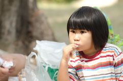 Asian Little Girl eating outdoor Royalty Free Stock Photos