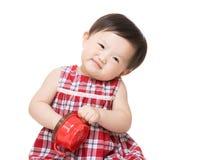 Free Asian Little Girl Eating Snack Stock Image - 38263331