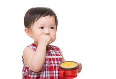 Asian little girl eating snack Royalty Free Stock Image