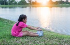 Asian little girl exercise on park stock image