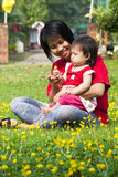 Asian little girl in green Lawn Stock Images