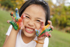 Girl with hands painted in colorful paints Royalty Free Stock Image