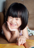 Asian little girl happy to reading  book Stock Photography