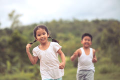 Asian little girl having fun to run and play with her friend Stock Image