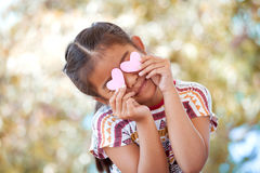 Asian little girl with hearts on the eyes Royalty Free Stock Photo