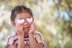 Asian little girl with hearts on the eyes Stock Photo