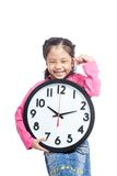 Asian little girl hold a clock and laughing Royalty Free Stock Photo