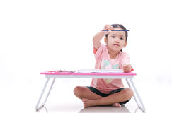 Asian little girl holding color pencil isolated on white backgro Stock Images
