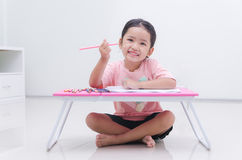 Asian little girl holding color pencil Stock Photo