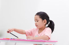 Asian little girl holding color pencil Royalty Free Stock Photo