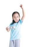 Asian little girl holding games joystick controller on white bac Stock Photos