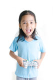 Asian little girl holding games joystick controller on white bac Royalty Free Stock Image