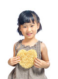 Asian little girl holding the heart pouch Stock Photography