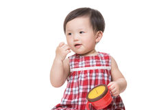 Asian little girl holding her food box Stock Image