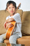 Asian little girl holding ukulele Stock Images