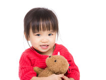 Asian little girl hug with doll Stock Image